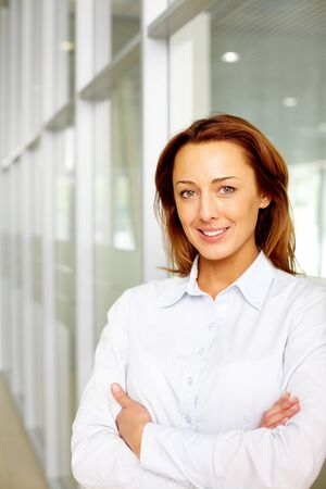 Portrait of smiling businesswoman looking at camera  Stock Photo - 11118920