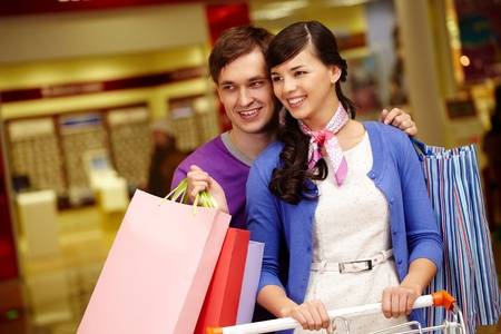Portrait of happy couple shopping in the mall Stock Photo - 11236345