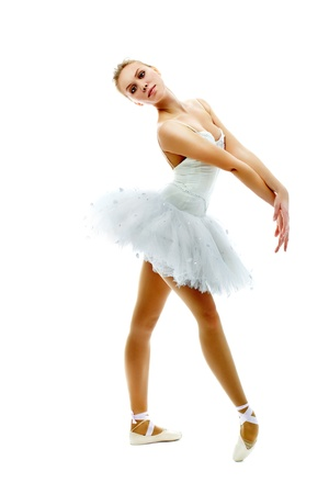 Portrait of charming ballerina performing dance on white photo