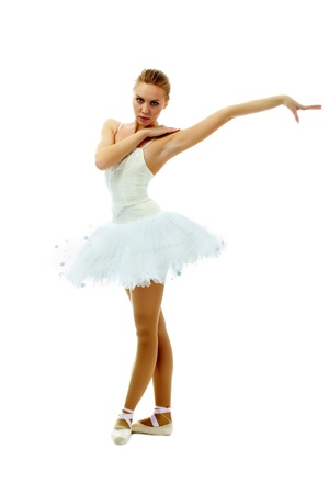 Portrait of charming ballerina with stretched arm on white background