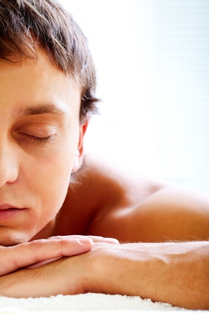 male facial: Face of calm guy enjoying spa procedure