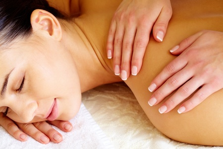 Close-up of pleased female during luxurious procedure of massage photo