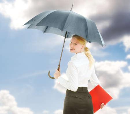 woman umbrella: Happy businesswoman under open umbrella stretching her arm