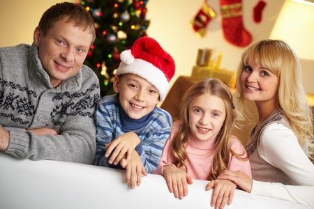 Portrait of four happy family members looking at camera with smiles Stock Photo - 11242407