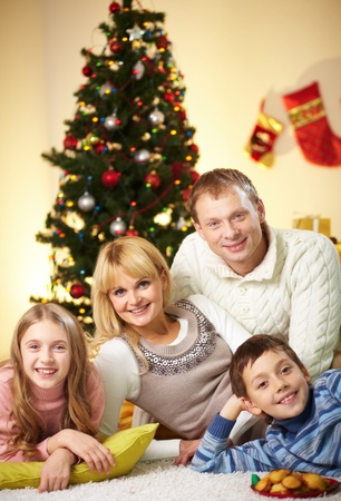 Portrait of four happy family members looking at camera with smiles Stock Photo - 11236339