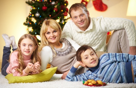 Portrait of four happy family members looking at camera with smiles Stock Photo - 11236337