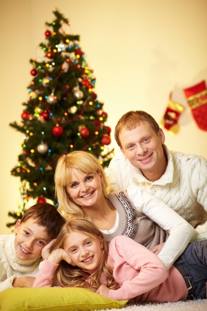 Portrait of four happy family members looking at camera at home Stock Photo - 11236349
