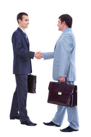 Photo of smart businessmen with briefcases handshaking on white background photo