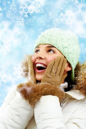 gloves women: Pleasantly surprised young woman smiles looking up