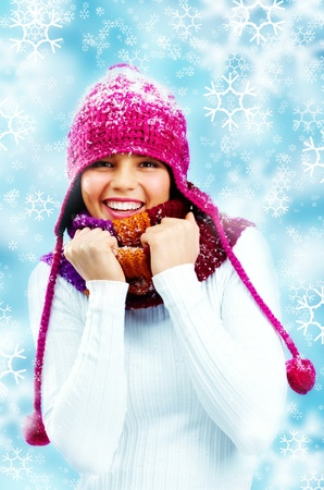 winterwear: Studio shot of a smiling girl in a pullover, scarf and cap