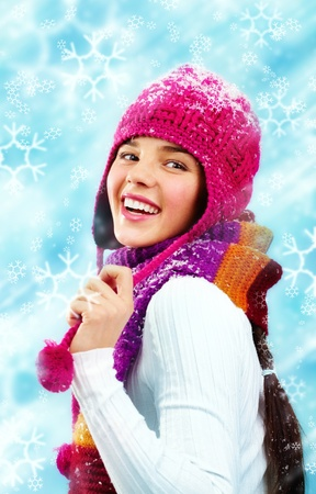 winterwear: Beautiful young woman in winter clothes looking back and smiling