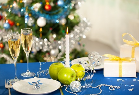 Image of holiday objects on Christmas table photo