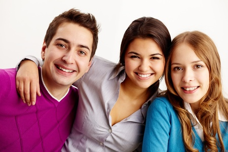 Portrait of attractive friends looking at camera and smiling Stock Photo - 11223105