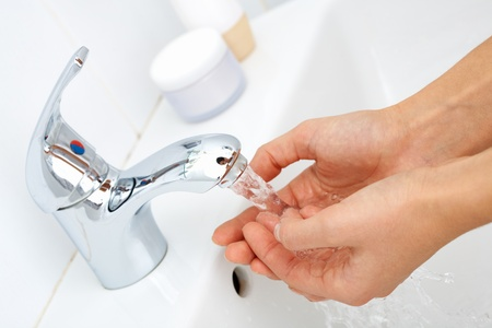 washing hands: Close-up of human hands being washed under stream of pure water from tap Stock Photo