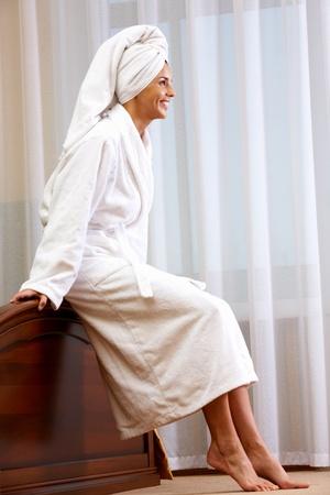 woman bathrobe: Portrait of pretty female in white bathrobe with towel on head Stock Photo