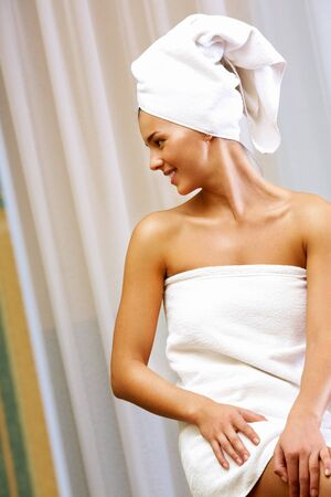 pureness: Portrait of pretty female wrapped in towel after bath