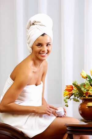 pureness: Portrait of pretty female wrapped in towel looking at camera with smile
