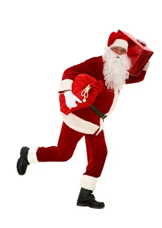 Photo of happy Santa Claus running with red giftbox and sack in hands