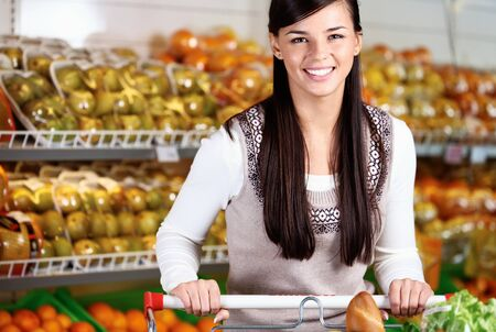 Image of pretty woman looking at camera in supermarket Stock Photo - 11268448
