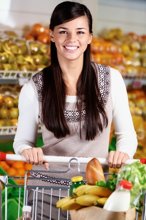 Image of pretty woman with cart looking at camera Stock Photo - 11268467