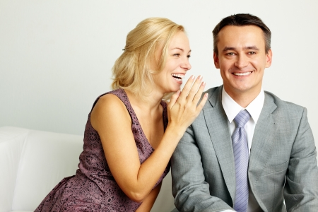 communicate: Photo of happy man and woman talking and laughing