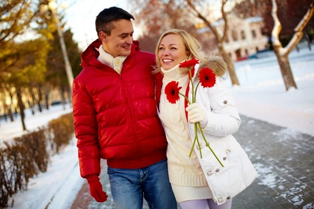 herbera: Photo of happy man and pretty woman walking outdoor in winter
