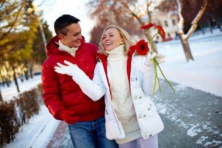 couple winter: Photo of happy man and pretty woman walking outdoor in winter