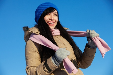 Portrait of healthy woman in winter clothes looking somewhere outside photo