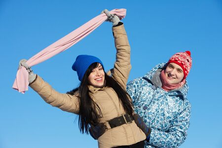 winterwear: Portrait of happy couple in warm clothes looking at camera outside