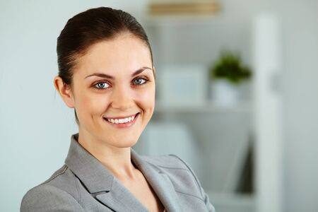 Portrait of successful businesswoman looking at camera with smile photo