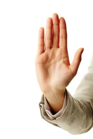 alzando la mano: Imagen de la mano de la mujer que muestra se�ales de detenerse Foto de archivo