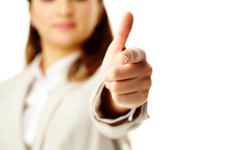 Photo of female hand with forefinger pointing at you photo