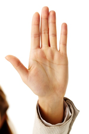 negation: Image of female hand showing sign of stop Stock Photo