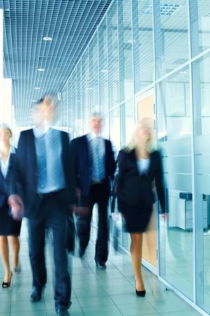 Enthusiastic business team following the corridor