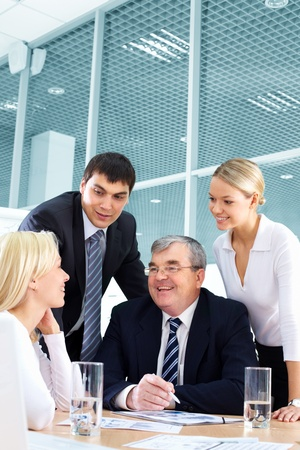 interacting: Businesspeople developing a successful business plan