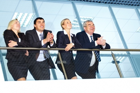 Business people looking away from camera and smiling photo