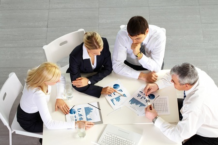 business consulting: Above view of business team discussing future strategy