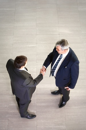 Over view of two businessmen shaking hands photo