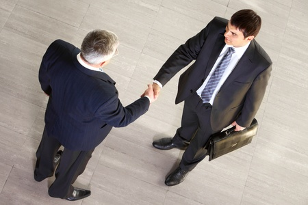 concluding: Over view of two businessmen concluding a deal