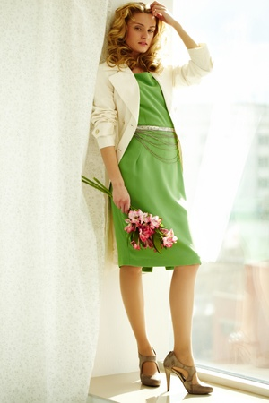 Young woman in stylish outfit depicted full-length