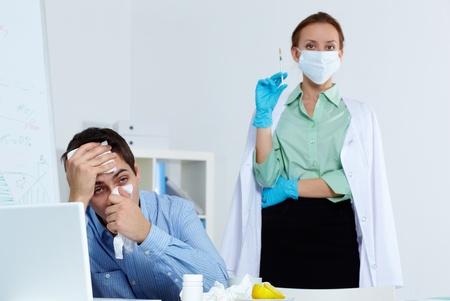 catarrh: Image of businessman sneezing with nurse holding syringe on background