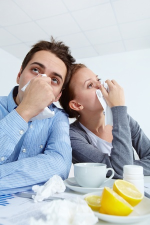 Image of sick business partners with rhinitis sitting in office  Stock Photo - 11425819