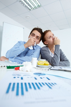 Image of sick business partners with rhinitis sitting in office  Stock Photo - 11425816