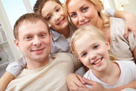 Close-up of a smiling family of four Stock Photo - 11425775