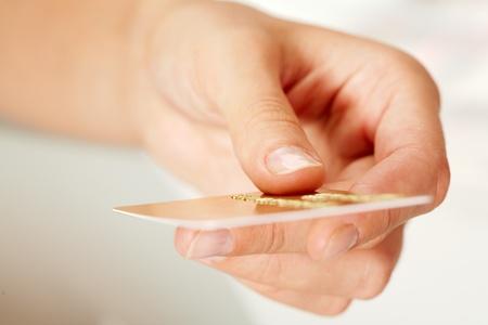 Macro image of plastic card in human hand photo