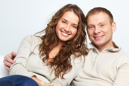 Happy couple looking at camera with smiles photo