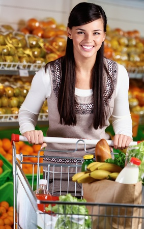 Image of pretty woman with cart looking at camera Stock Photo - 11425881