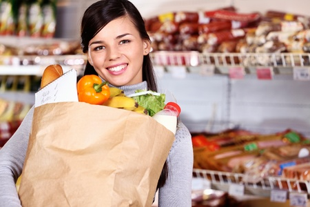 Image of pretty woman with pack of products looking at camera Stock Photo - 11425879