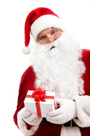 santa cap: Photo of happy Santa Claus with small decorated box