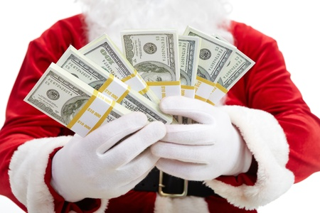 Close-up of Santa's hands with stacks of dollar banknotes photo